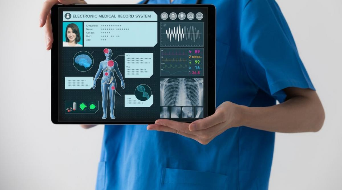 A pharmacist holding an iPad in her hand and using a Medical app.